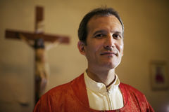 http://www.dreamstime.com/royalty-free-stock-image-portrait-happy-catholic-priest-smiling-camera-church-man-faith-altar-looking-image31076836