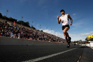 An athlete enters Panathinaikon stadium during the 30th Athens Classic Marathon race in Athens, Sun. Nov. 11 2012. More than 20,000 athletes competed at the classic marathon route and the smaller races of five and ten kilometers. (AP Photo/Kostas Tsironis)