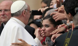 VATICAN CITY, VATICAN - MARCH 27:  A woman kisses the hand of Pope Francis as he greets the crowd around St Peter's Square after his first weekly general audience as pope on March 27, 2013 in Vatican City, Vatican. Pope Francis held his weekly general audience in St Peter's Square today  (Photo by Christopher Furlong/Getty Images)